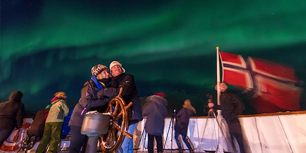 People Looking up at the Northern lights