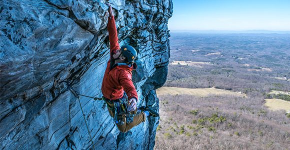 Rock climber in America, scaling a mountain alone